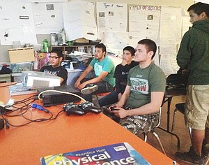 Settling in for a day of video game mastery are Mabton High School students (L-R) Jose Altamirano, Omar Orozco, Enrique Leyva and Nathan Herrera. Altamirano was named PlayStation tournament winner after 5-1/2 hours of play.