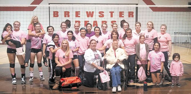 The Brewster Bears volleyball team recently participated in a fundraiser for breast cancer awareness, lead by Starr Hammons (pictured sitting). In the white shirt is scorekeeper Ellen Dezellem.