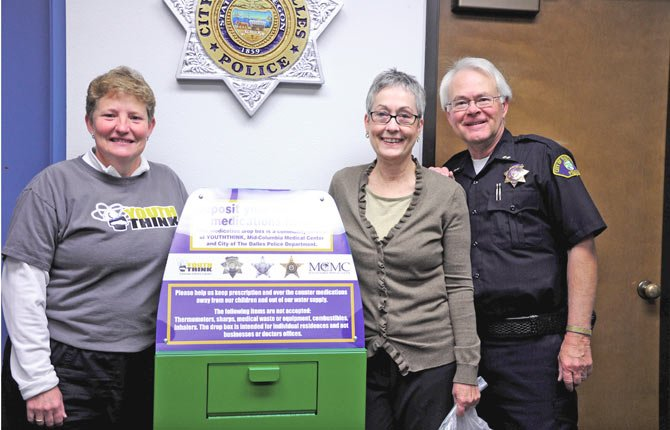 THE DALLES POLICE now have a drop-off box where residents can dispose of outdated or unused medications. It was purchased through donations from Mid-Columbia Medical Center and YouthThink. Pictured above are, from left, Debby Jones, YouthThink coordinator; Linda Stahl, director of MCMC's Planetree Health Resource Library; and The Dalles Police Chief Jay Waterbury. 	Conributed photo