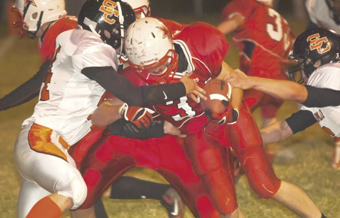DUFUR junior Trever Tibbets (middle) breaks through Sherman's defense to give the Rangers an early 14-0 lead in the opening quarter of Friday's Big Sky Conference football game in Dufur. Tibbets accounted for 312 total yards and four touchdowns to lead the No. 3 Rangers to a 52-6 victory over Sherman.