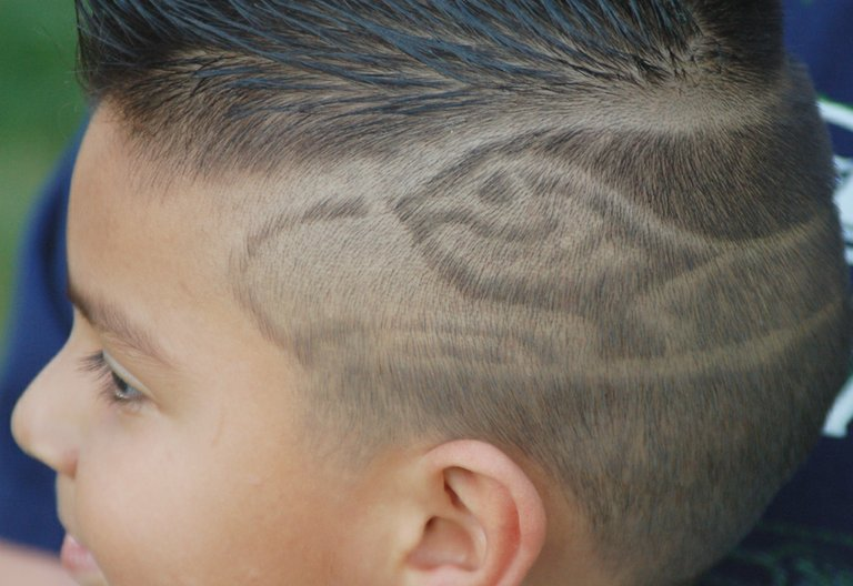 Five-year-old Noah Gonzalez of Sunnyside shows his 12th Man spirit with a new hairdo he acquired this past Monday. Gonzalez and other Seahawk fans have plenty to cheer about with the Seattle team boasting the best record in the NFC.