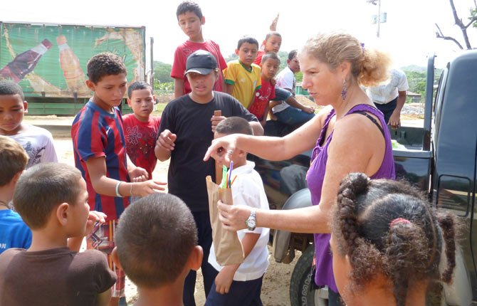 A HONDURAS TEACHER distributes art supplies collected by St. Mary's Academy teacher Lise Larsen.