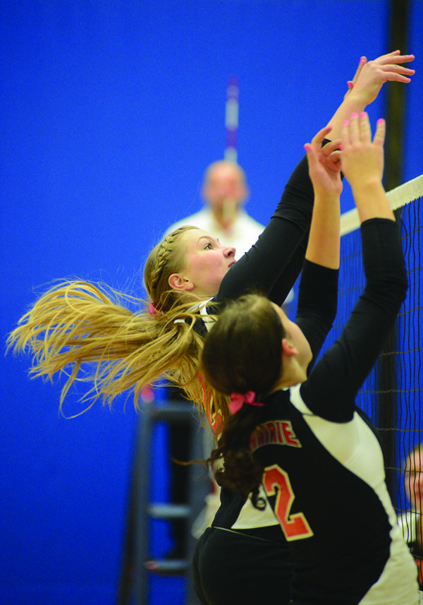 Prairie's Kayla Schumacher (left) and Natasha Gimmeson challenge a hit by Troy during the 1AD1 District II volleyball on Oct. 21.
