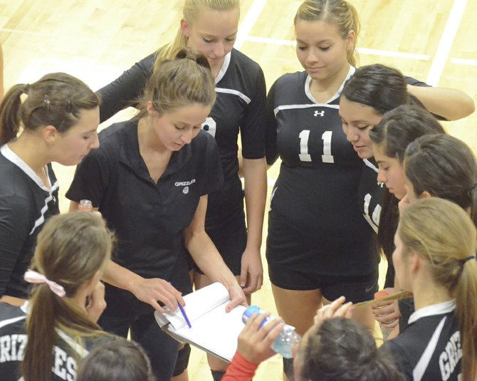 Sunnyside Volleyball Coach Jordyne Jaquish between the first and second sets of last night's match talks to her players about strategy.