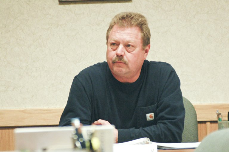 Port of Sunnyside Commissioner Jim Grubenhoff listens during a discussion on the sale of Port property during last night's meeting.