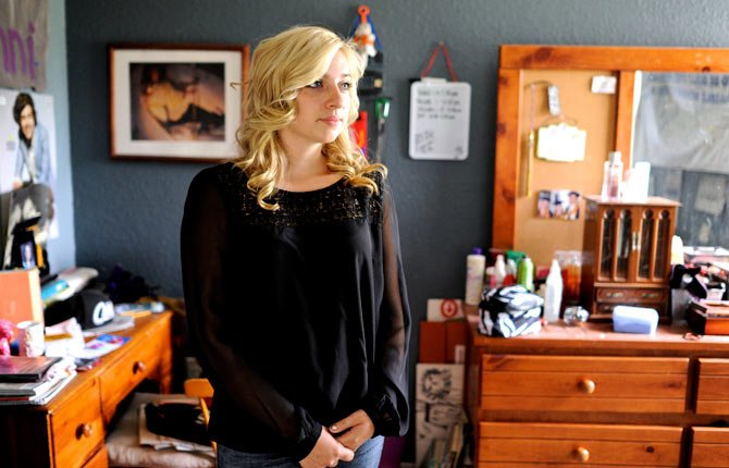 "Sarah Ball, a victim of cyber bullying during her high school years, poses for a portrait at her home on Wednesday, Oct. 23 in Spring Hill, Fla. Ball, now a student at a nearby community college, maintains a Facebook site called ""Hernando Unbreakable"", an anti-bullying page and mentors local kids identified by the schools as victims of cyberbullying."