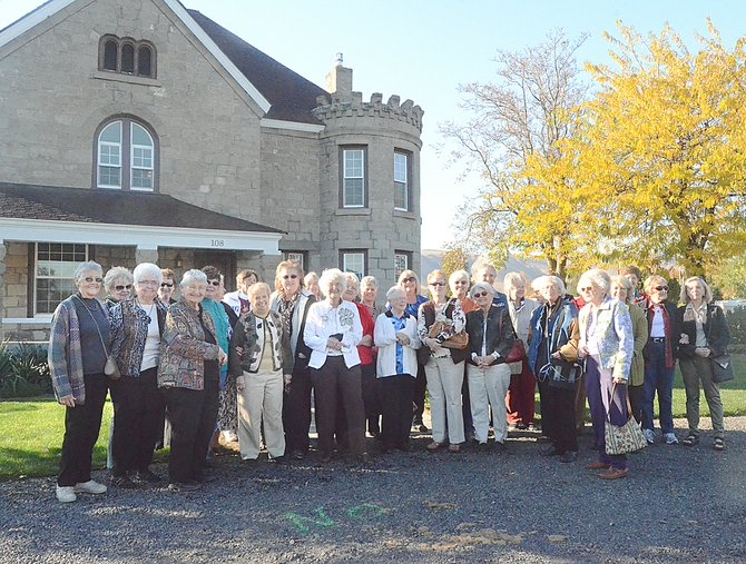 The Carmichael Castle in Union Gap was constructed in 1902 by Elizabeth Carmichael, founder of Yakima Creamery. It is one of two homes she owned in the area. Here, members of Sunnyside's Nouvella Club visit the home.