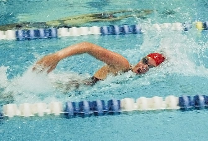 SHS sophomore Summer Hazzard churns through the water in a freestyle sprint at last Saturday's Yakima Valley Championships at Yakima's Lions Pool.