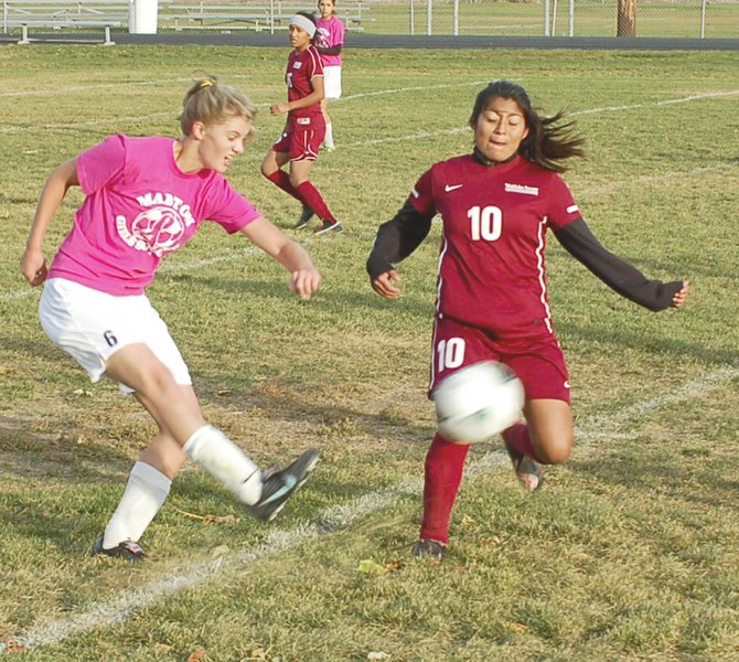 Mabton's Micki Williams delivers a pass before a Wahluke player can get to the ball.