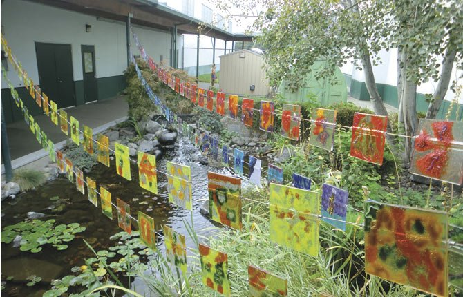 STUDENT-DESIGNED glass art is just one of Chenowith Elementary School's unique educational projects, according to principal Anne Evans. See page A7 for more details.