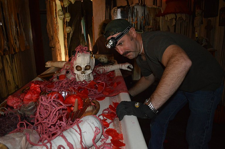 Paul Henke working on the haunted house.