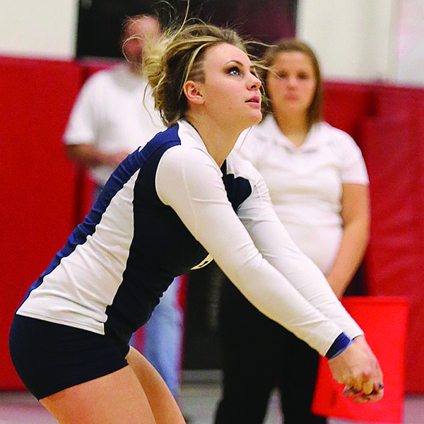 GHS senior Delanie Adams looks to make a pass from the back row.
