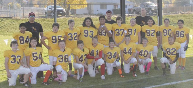 THE DALLES' football All Stars take a team photo to commemorate their first trip for two exhibition games at Eastern Oregon University in La Grande. In the front row are (pictured from left to right) Blane Turner-Denley, Ophath Silaphath, Mac Cope, Jacob Buell, Caden Mathisen, Gio Avila, Michael Armstrong, Ben Nelson and Asa Farrell.  In the middle row are(from the left), Josue Quintin, Trenton Schacher, Mac Abbas, Mercy Iaulualo, Dalles Seufalemua, Sam Thalhofer, Hayden Pashek, Miguel Torres, Zac Bullock and Xavier Orion-Olaez. In the back row are coaches (from the left), John Schacher, Joe Abbas and Dan Nelson.
