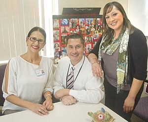Familiar faces at Lower Yakima Valley community health fairs are (L-R) Nora Gonzales, Nathan Marchello and Monica Escareno. The trio was on hand Tuesday for the open house held at Sunnyside's Center for Community Health Promotion, a satellite of Fred Hutchinson Cancer Research Center of Seattle.