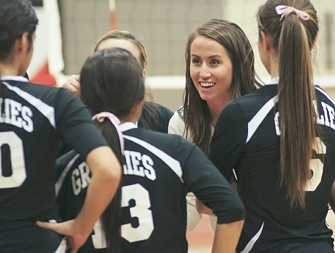 Sunnyside volleyball coach Jordyne Jaquish encourages her players during a break. The Lady Grizzlies earned their second victory of the regular season last night and will compete for District seeding tomorrow (Thursday) at Hanford.