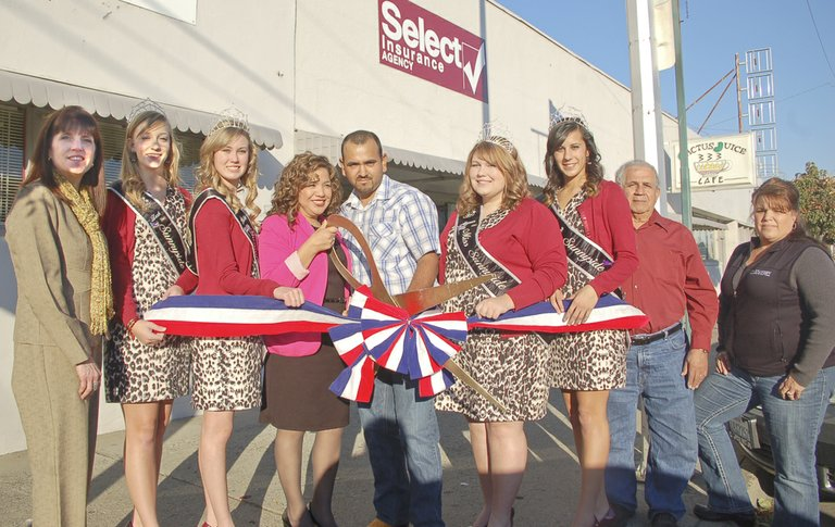 Select Insurance at 626 Decatur Ave. was the site for a Sunnyside Chamber of Commerce ribbon cutting this past Tuesday afternoon. Owners Leticia and Luis Sandoval (C) are surrounded by chamber members and the Miss Sunnyside Court for the occasion. Pictured are (L-R) Dorris Kresse, Miss Sunnyside Princess Leah Diddens, Miss Sunnyside Princess Ashley Davis, the Sandovals, Miss Sunnyside Alyson Spidle, Miss Sunnyside Princess Tiana Perez, Ruben Carrera and Sunnyside Chamber of Commerce Executive Director Pam Turner.