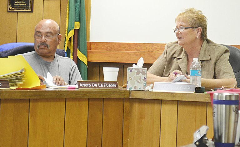 The city of Mabton last night got a first look at the preliminary budget for 2014. Pictured are Councilman Arturo De La Fuente and Mayor Vera Zavala.