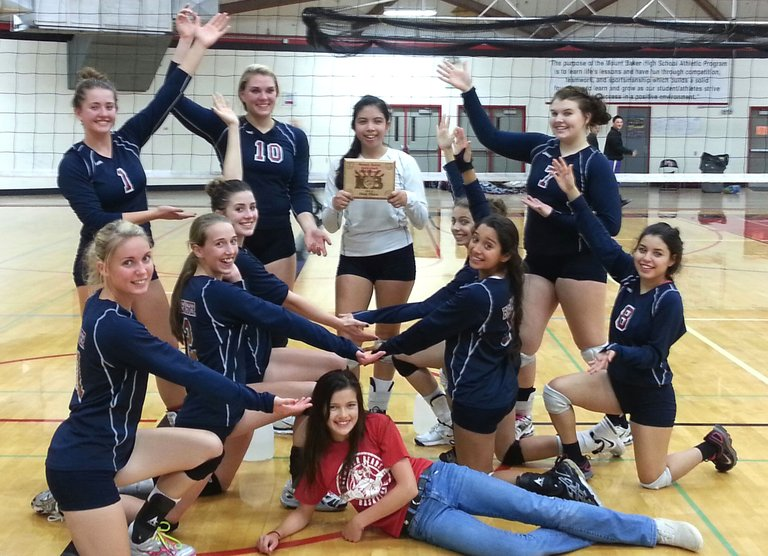 Members of the Brewster High School volleyball team celebrate going 6-0 and winning the Mount Baker Mountaineer Volleyball Invitational on Oct. 26.