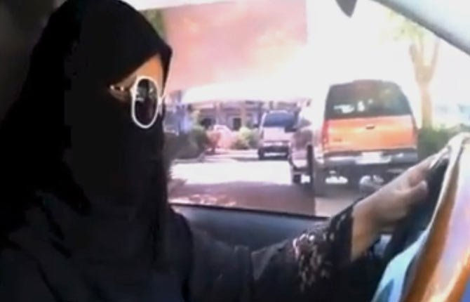 a Saudi woman drives a vehicle in Riyadh, Saudi Arabia, Saturday, Oct. 26. A Saudi woman said she got behind the wheel Saturday and drove to the grocery store without being stopped or harassed by police, kicking off a campaign protesting the ban on women driving in the ultraconservative kingdom.