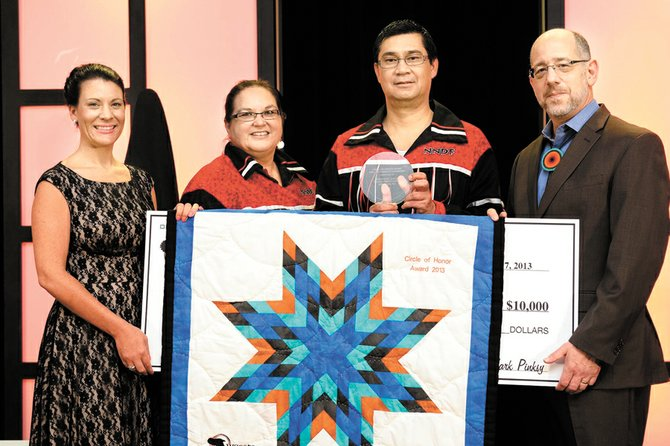 First Nations Oweesta Corp. Executive Director Chrystal Cornelius, far left, and Opportunity Finance Network Executive Director Mark Pinksky, far right, congratulate Northwest Native Development Fund Chairwoman Molly Morris, second from left, and Northwest Native Development Fund Executive Director Ted Piccolo, second from right.