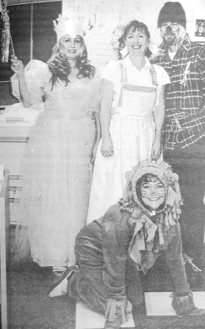 2003: Staff at Chief Kamiakin Elementary School dressed as characters from The Wizard of Oz. Pictured are (standing L-R) Mirtha Pearson as Glinda, Val Eshelman as Dorothy and Darin Moore as the Scarecrow. In front is Ludine Siller as the Cowardly Lion.