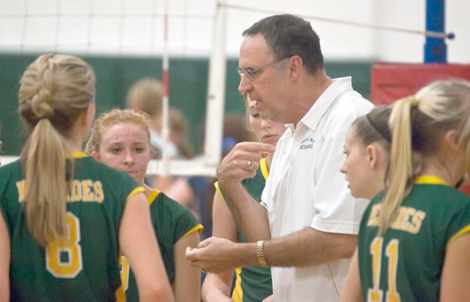 SOUTH WASCO COUNTY coach and Big Sky Conference Coach of the Year, Ron Townsend, goes over instructions in-between sets in a match this season in Maupin. Along with Townsend, SWC had two players on the first team and Joy Kelly, Kelsie Olson and Molly Foreaker penciled in as honorable mentions.