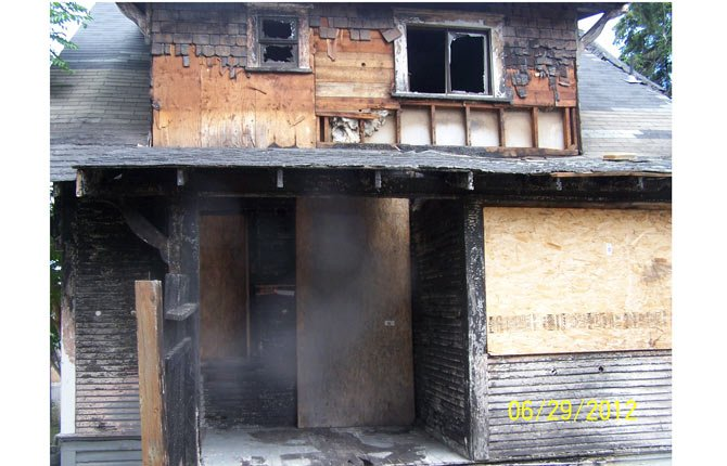 CITY OF The Dalles is foreclosing on properties with unpaid code enforcement liens, including a $45,000 tab to demolish this burned-out residence.	Contributed photo