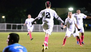 Oscar Munoz celebrates a goal with teammates Rogelio Lachino and Armando Hernandez.