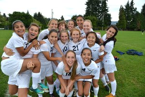 IN HIGH SPIRITS: HRVHS varsity girls soccer team members Monique Diaz, Anna Schlosser, Thania Tor-res, Lucy McLean, Sophia Marble, Lily Zega, Korey Cimock, Jenissa Ramirez, Vanessa Silva, Miga McCur-dy, Hannah Bergemann, Kara Kiyokawa, Cielo Rivera and Laura De La Torre pose for a group photo earlier this sea-son.
