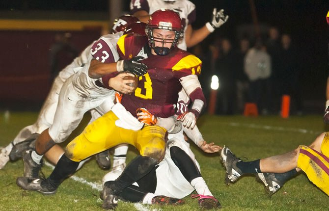 The Dalles Wahtonka senior quarterback Chaise Shroll, center, is finally brought down by Franklin defender DeAnthony Hartley as the Eagle Indians get within scoring range Nov. 1.