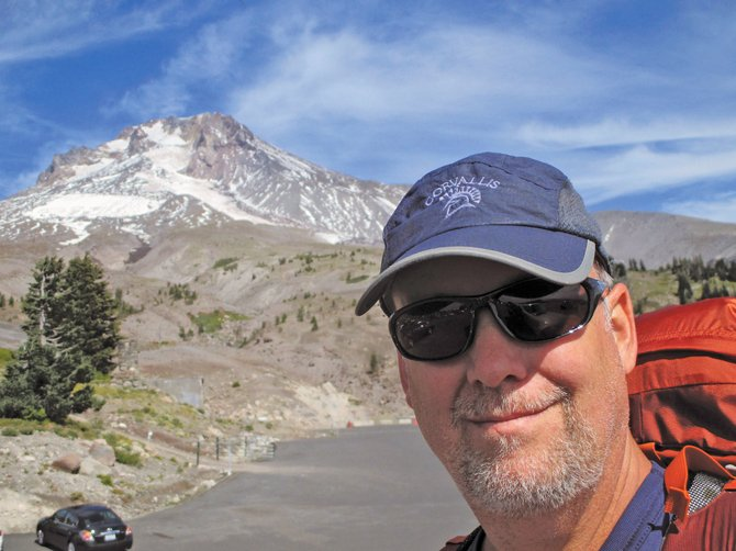 Bennett Hall takes a self portrait with Mount Hood in the background near Government Camp Sept. 20 after finishing the 40-mile Timberline Trail around the mountain.