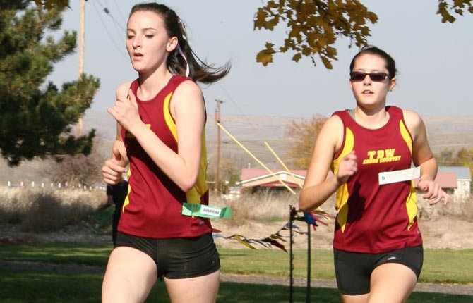MADDIE WOOD, left, and Emily Morin led The Dalles Wahtonka girls harriers in their bid at the OSAA Class 5A state meet.