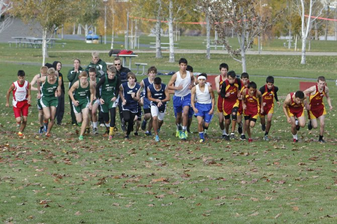 Boys competing in the 1B/2B District 5-6 cross country meet start the 3-mile race Saturday through Walla Walla Point Park in Wenatchee.