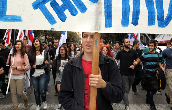 Students shout slogans during a rally in the northern Greek port city of Thessaloniki, Wednesday, Nov. 6. Services across Greece shut down Wednesday as unions held a 24-hour general strike to protest further austerity cuts in the cash-strapped country.