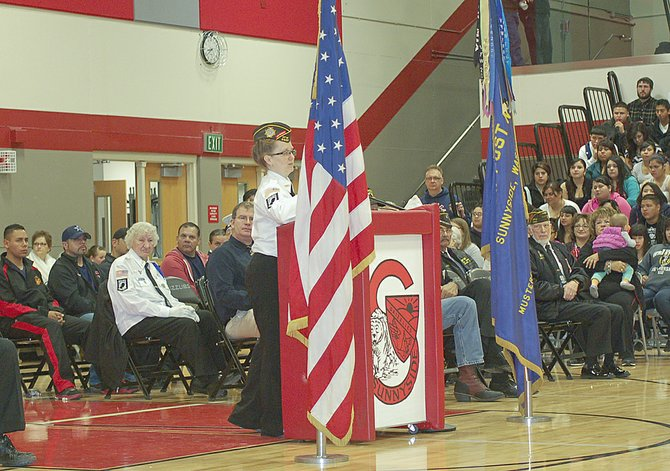Delessa Restucci, a1986 Sunnyside High School alumni, shares memories of her 17-year history of military service, with the Sunnyside High School student body during yesterday's annual Veterans Day assembly.