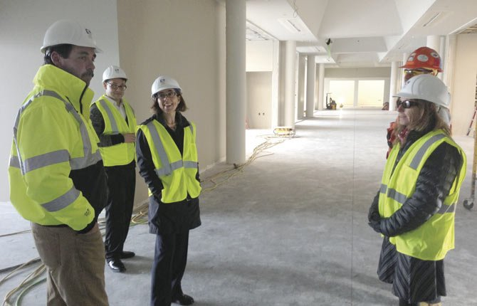 Oregon Secretary of State Kate Brown, third from left, visits the new workforce training center under construction at Columbia Gorge Community College on Wednesday.