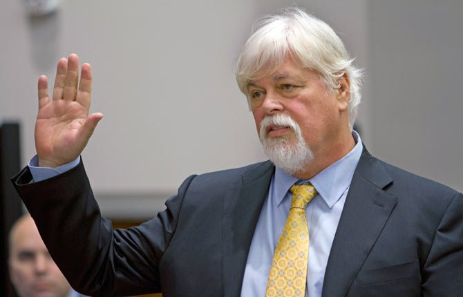 Anti-whaling activist Paul Watson, founder of the Oregon-based Sea Shepherd Conservation Society, is sworn in before testifying during a contempt of court hearing in federal court, Nov. 6, in Seattle. Japanese whalers argue that Watson's organization on 10 occasions violated an order barring its vessels from attacking or coming within 500 yards of the whaling ships.