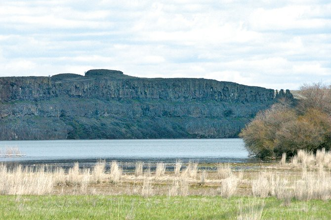 Water-carved basalt cliffs rise above Rock Lake between Sprague and St. John in southeastern Washington.