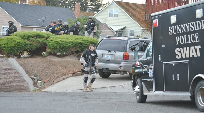 The Sunnyside Police Department's SWAT team was asked by the LEAD Task Force of Yakima County to assist yesterday, Thursday, with a search in the 100 block of Thill Avenue. Sunnyside Police Sergeant Joey Glossen said the search was part of an ongoing narcotics investigation by the task force in which multiple warrants and arrests were made yesterday in the Grandview and Sunnyside areas. Among the other agencies on-scene here in Sunnyside was the State Patrol's K-9 unit. Sunnyside's SWAT team assisted the search for about an hour and, as a precaution, traffic was blocked in the area during that time.