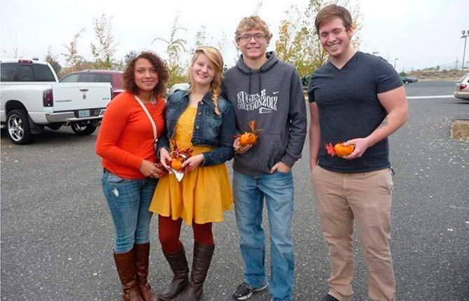 THE DALLES YOUTH Heart of Hospice participants, from left, Alicia, co-presidents Hannah and Blake, and volunteer Sean prepare to deliver mini-pumpkins to hospice patients. 	Contributed photo
