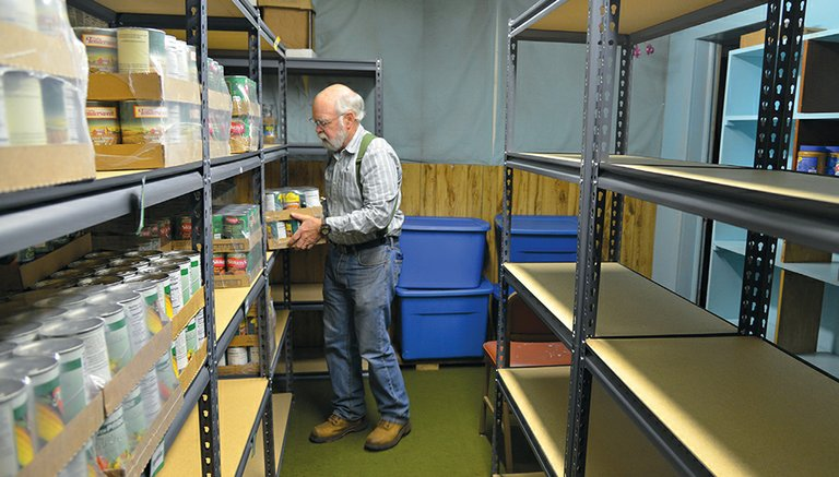 VO LUNTEERS Craig Terry  prepares for another day at the FISH Food Bank in Hood River. Community donations for the county's four food banks are crucial this time of year.  Photos by  Adam Lapierre