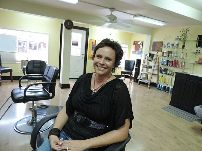 "NANNETTE MORTENSEN is giving back by hosting ""free haircut Friday"" for FISH food banks through Dec. 24."