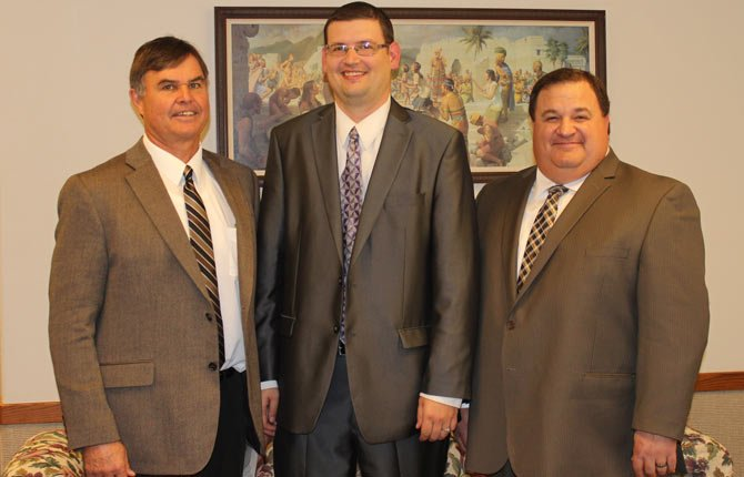 THE DALLES FIRST WARD of the Church of Jesus Christ of Latter-day Saints has named a new bishop, Jeff Hodges, pictured center. To the left and right of him are new counselors Mike North and Steve Byers.  Contributed photo