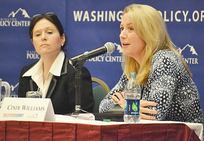 The charter school movement was a focal point for one of the larger sessions at this week's Solutions Summit, which attracted about 300 participants in total. Cindi Williams (R) of the Washington State Charter School Commission addresses misconceptions about the charter movement. Dr. Shelley Redinger (L) is superintendent of Spokane Public Schools and during the discussion shared successes she has experienced with charter schools.