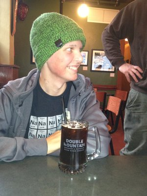 "OWEN Stolte enjoys a glass of ""Oh-Man"" root beer crafted in his honor, and benefit, at Double Mountain. The brewery will host a benefit for Owen on Dec. 7."