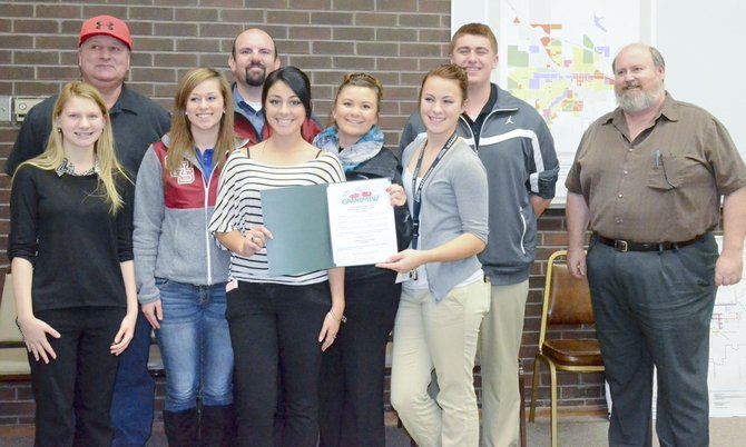 The city of Grandview last week recognized Grandview High School's DECA chapter for its service to the community with a proclamation for DECA Week, which is being observed Nov. 18-24. Pictured are (front L-R) Amanda Oliver, Kylie Serl, Wendy Magana, Alicia Gonzalez, Miranda Ebbelaar, Matt Daley and Mayor Norm Childress; (back L-R) Mike Carpenter and DECA Advisor Brad Charvet.