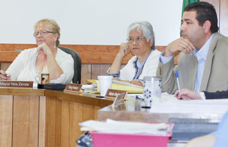 Mabton Mayor Vera Zavala and Councilmen Oping Hutson and Mario Martinez (L-R) listen to city staff reports regarding the city's need to drill a new city well, during Tuesday's council meeting. Following the public works report, the council asked staff to come back to council with new rate increases for both water and sewer services.