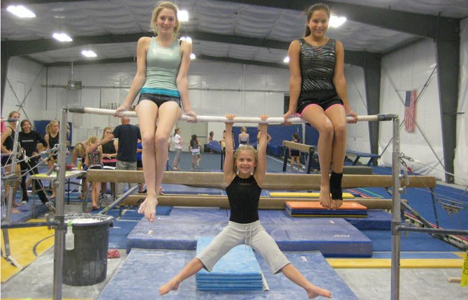 RIVERSIDE GYMNASTICS athletes (pictured from left to right), Meara Crawford, Zoe LeBreton and Karla Hernandez took home some first-place hardware after putting up big numbers at the Ghostbusters Gymnastics Meet in Tigard on Oct. 26. Both the Level 3 and 4 teams racked up third-place honors.   Contributed photo