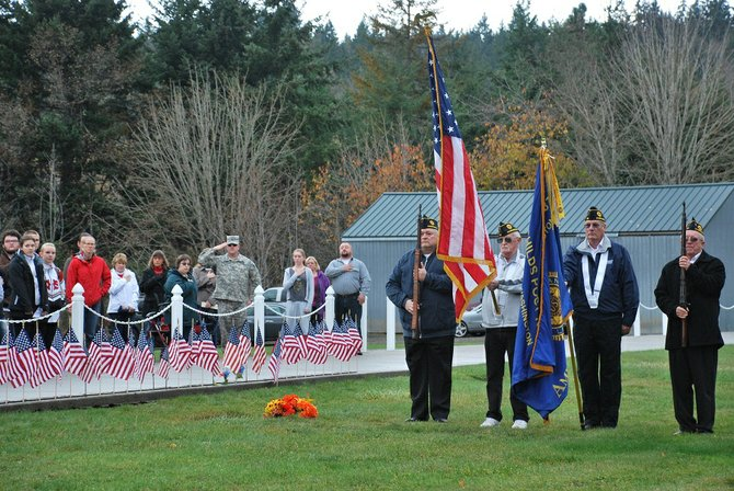 Members of the American Legion Evan Childs Post No. 87 present the colors at the White Salmon Cemetery's Walk of Honor memorial when Columbia High School students attended a ceremony honoring veterans on Friday.