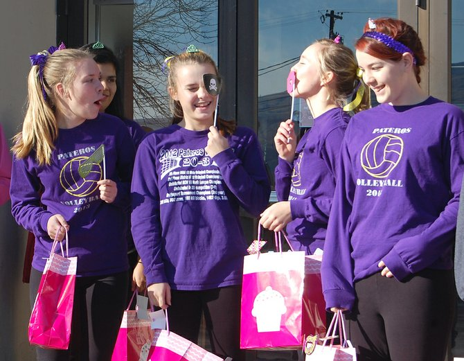Pateros volleyball players, from left to right, Emily Larsen, Emmalee Luft, Katarina Wilson and Kerlyn Heen receive gifts before embarking on the trip to Yakima for the state volleyball tournament Thursday.